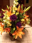 orange lilies and purple carnations