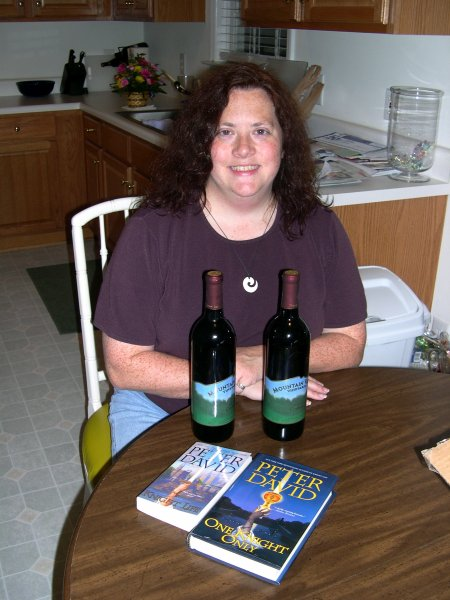 Cynthia's presents, opened (Cynthianna wine, and 2 Peter David books)