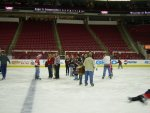 a big group of folks congregating in the center of the ice