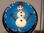 A rather promiscuous snowman cake.