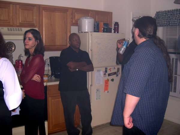 (Cynthia's arm), Holly, Jeff, Shep, and Chris hanging out in the kitchen