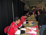 Kostopoulos signing Stephanie's jersey