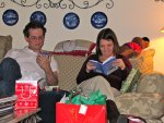 Jon and Anna looking at their presents