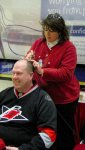 getting a hurricanes logo painted on his, um, bald spot =)