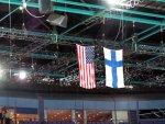 American and Finnish flags hanging from the ceiling