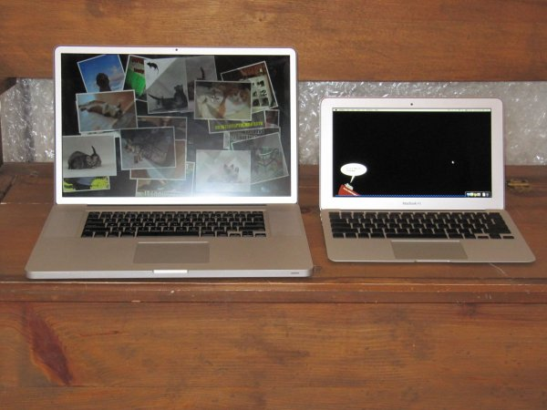 "new 11"" MacBook Air next to the old 17"" MacBook Pro"