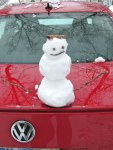 a Christmas tradition: snowman on the car!