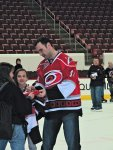 Jay Harrison signing autographs on the ice