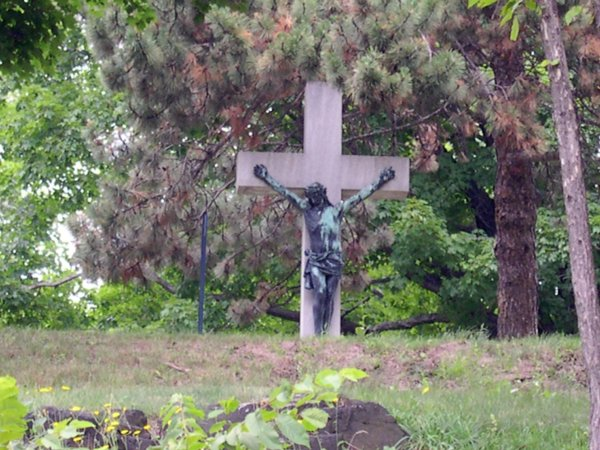 Cemetery - Crucifix tombstone on the hill.