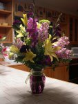 purple gladiolas and snap dragons, and yellow lilies