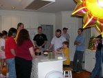 the whole group, Matthew is lighting the cake