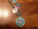 "close-up of the ""Why Grow Up?"" necklace"